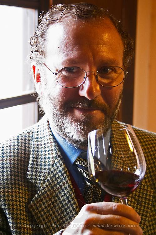 Juan Luis Bouza, owner, tasting a glass of wine. Bodega Bouza Winery, Canelones, Montevideo, Uruguay, South America