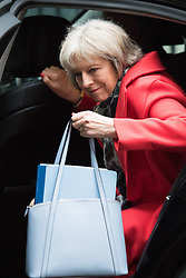 Downing Street, London, February 11th 2016. Home Secretary Theresa May steps out of her car as she attends the weekly cabinet meeting. <br /> ©Paul Davey<br /> FOR LICENCING CONTACT: Paul Davey +44 (0) 7966 016 296 paul@pauldaveycreative.co.uk