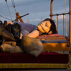 LIVERPOOL, UK, 20th April, 2012. The Sea Odyssey. The little girl giant and her dog Xolo fast asleep at Kings Dock.