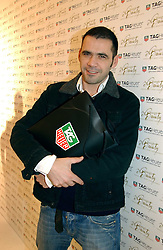 ROLAND MOURET attending the Tag Heuer party where an exhibition of photographs by Mary McCartney celebrating 15 exception women from 15 countries was unveiled at the Royal College of Arts, Kensington Gore, London on 8th February 2007.<br /><br />NON EXCLUSIVE - WORLD RIGHTS