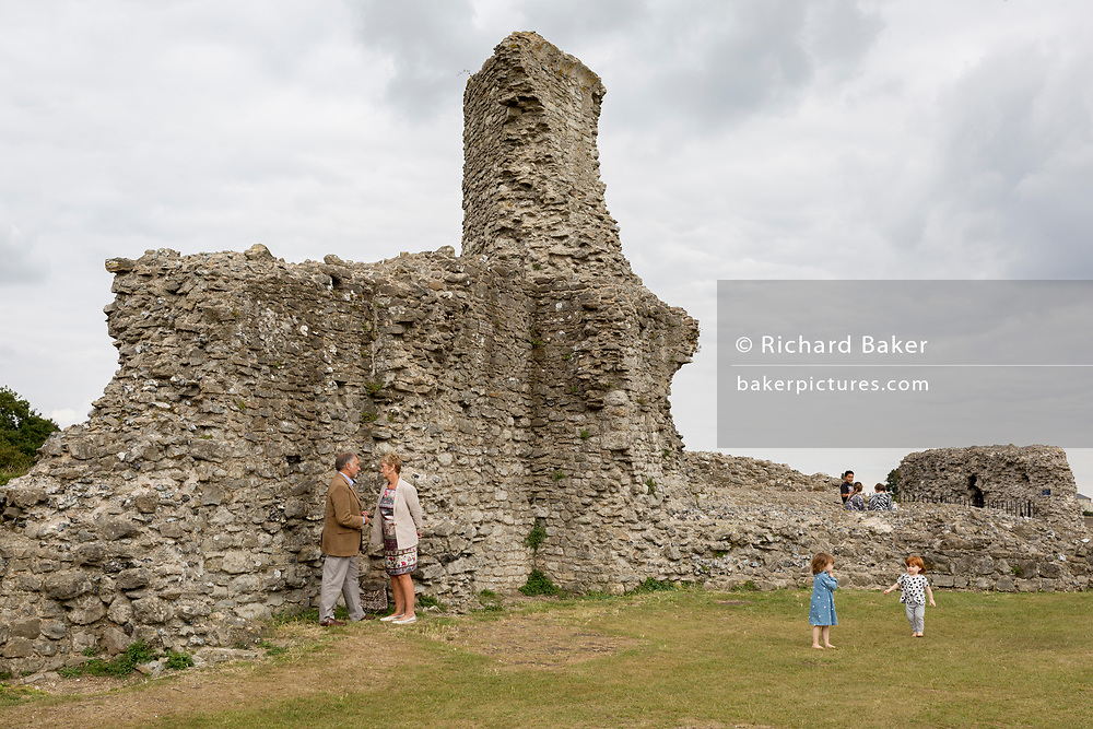 Visitors at the remains of Hadleigh Castle on 10th September 2019, in Hadleigh, Essex, England. Hadleigh Castle is a ruined fortification in the English county of Essex, overlooking the Thames Estuary from south of the town of Hadleigh. Built after 1215 during the reign of Henry III by Hubert de Burgh, the castle was surrounded by parkland and had an important economic and defensive role. The castle was significantly expanded and remodelled by Edward III, who turned it into a grander property,