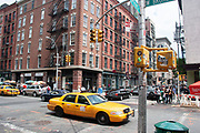 West Broadway street scene with New York yellow taxi cab, traffic lights and  people on 20th May 2007 in New York City, United States.