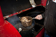 SWEETWATER, TX - MARCH 14: A Jaycees volunteer fries a batch of western diamondback rattlesnakes during the 51st Annual Sweetwater Texas Rattlesnake Round-Up, March 14, 2009 in Sweetwater, Texas. Approximately 24,000 pounds of rattlesnakes will be collected, milked for venom and the meat served to support charity. (Photo by Richard Ellis)