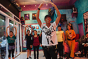 A young man teaches dance choreographies for a women group for a fifteenth birthday party in Ciudad Nezahualcoyotl, June 28, 2012.