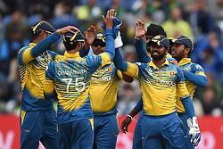 Sri Lanka's Dhananjaya de Silva and Niroshan Dickwella (right) celebrate taking the wicket of Pakistan's Babar Azam during the ICC Champions Trophy, Group B match at Cardiff Wales Stadium.