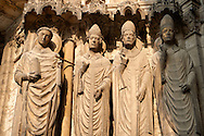 South Porch, Right Portal, Left Jambs. Cathedral of Chartres, France. Gothic statue of the four ?Confessors? important intellectual and spiritual leaders, most of whom lived during the early centuries of the Church. They stand on historiated socles- there are canopies offer their heads with architectural motifs. From left to right they are .1) Laumer (also called Lomer or Laudomarus), a local saint who was founder and Abbot of the nearby monastery of Corbion in the 6th century..2) Pope Leo I, an influential early Pope.3) a figure that is either Ambrose or Thomas Becket .4) Nicholas, bishop of Myra (two of his miracles appear in the tympanum).The figure of Laumer was added after the rest of the portal was created. . A UNESCO World Heritage Site. .<br /> <br /> Visit our MEDIEVAL ART PHOTO COLLECTIONS for more   photos  to download or buy as prints https://funkystock.photoshelter.com/gallery-collection/Medieval-Middle-Ages-Art-Artefacts-Antiquities-Pictures-Images-of/C0000YpKXiAHnG2k