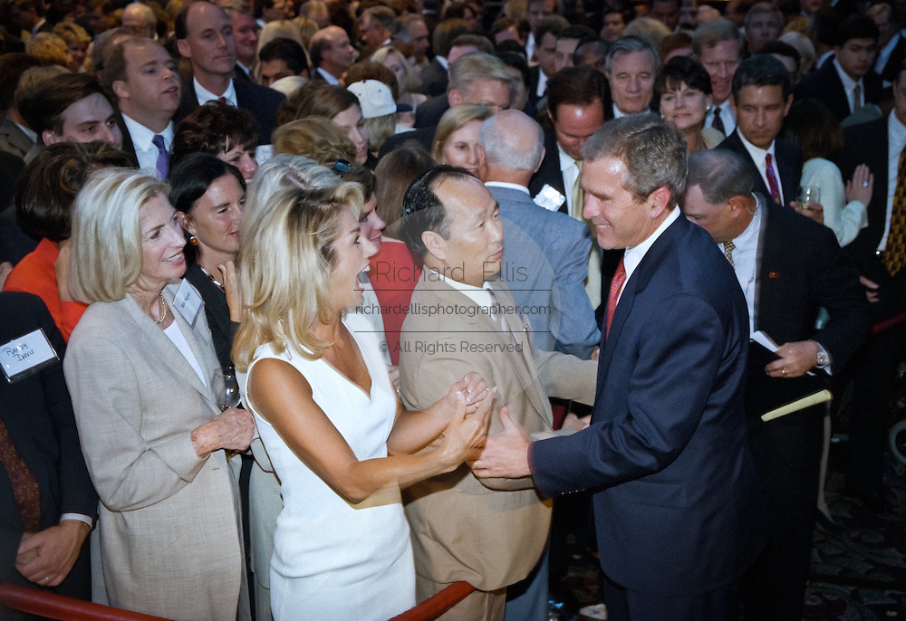 Texas Gov. George W. Bush shakes hands with supporters during a campaign fundraising event June 22, 1999 in Washington, DC. Bush is the frontrunner for the Republican presidential nomination in the Year 2000.