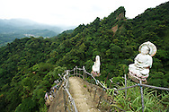 This mountain area seemed to have more religious statues and places to worship than many other areas that I've been to.  Most are Buddhist or Daoist (or a combination of the two).  Here, a statue of the Buddha and Matzu greet hikers to the peak of Xiaozi Shan.