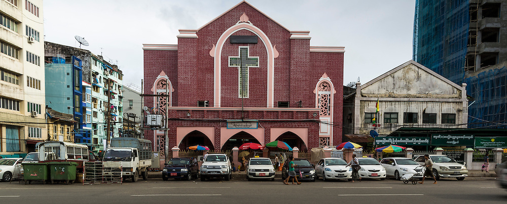 07 JUNE 2014 - YANGON, MYANMAR:  The U Naw Memorial Baptist Church in Yangon is one of the oldest Christian churches in Yangon. It was established in 1816. The current building was built in the 1930s. Yangon has the highest concentration of colonial style buildings still standing in Asia. Efforts are being made to preserve the buildings but many are in poor condition and not salvageable.    PHOTO BY JACK KURTZ