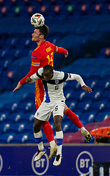 CARDIFF, WALES - Wednesday, November 18, 2020: Wales' Kieffer Moore (L) wins a header from Finland's Glen Kamara during the UEFA Nations League Group Stage League B Group 4 match between Wales and Finland at the Cardiff City Stadium. Wales won 3-1 and finished top of Group 4, winning promotion to League A. (Pic by David Rawcliffe/Propaganda)