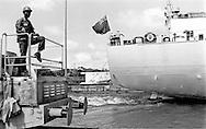 Panama Canal employee working the locomotive in the Miraflores Locks.