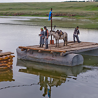 MONGOLIA. Local nomads use a hand-pulled pontoon  ferry across Shishgit River near Tsaagan Nuur, in Darhad Valley.