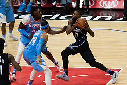March 10, 2018 - Los Angeles, CA, U.S. - LOS ANGELES, CA - MARCH 10: Orlando Magic forward Jonathon Simmons (17) drives to the basket against LA Clippers forward Montrezl Harrell (5) and LA Clippers forward Tobias Harris (34) during the game between the Orlando Magic and the LA Clippers on March 10, 2018, at STAPLES Center in Los Angeles, CA. (Photo by David Dennis/Icon Sportswire) (Credit Image: © David Dennis/Icon SMI via ZUMA Press)