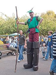 Stilt walker dressed as Robin Hood at Big Wheel event at Nottingham Castle.