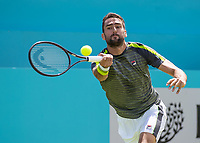 Tennis - 2019 Queen's Club Fever-Tree Championships - Day One, Monday<br /> <br /> Men's Singles, First Round: Marin Cilic (CRO) Vs. Christian Garin (CHL)  <br /> <br /> Marin Cilic (CRO) stretches to reach the passing drive on Centre Court.<br />  <br /> COLORSPORT/DANIEL BEARHAM