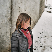 A young Layap girl. A walk around Laya village during a snow storm.