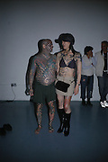 YOKO UKI AND MATT GONE. The Tattoo Convention. Old Truman Brewery.  October 7 2005. ONE TIME USE ONLY - DO NOT ARCHIVE © Copyright Photograph by Dafydd Jones 66 Stockwell Park Rd. London SW9 0DA Tel 020 7733 0108 www.dafjones.com
