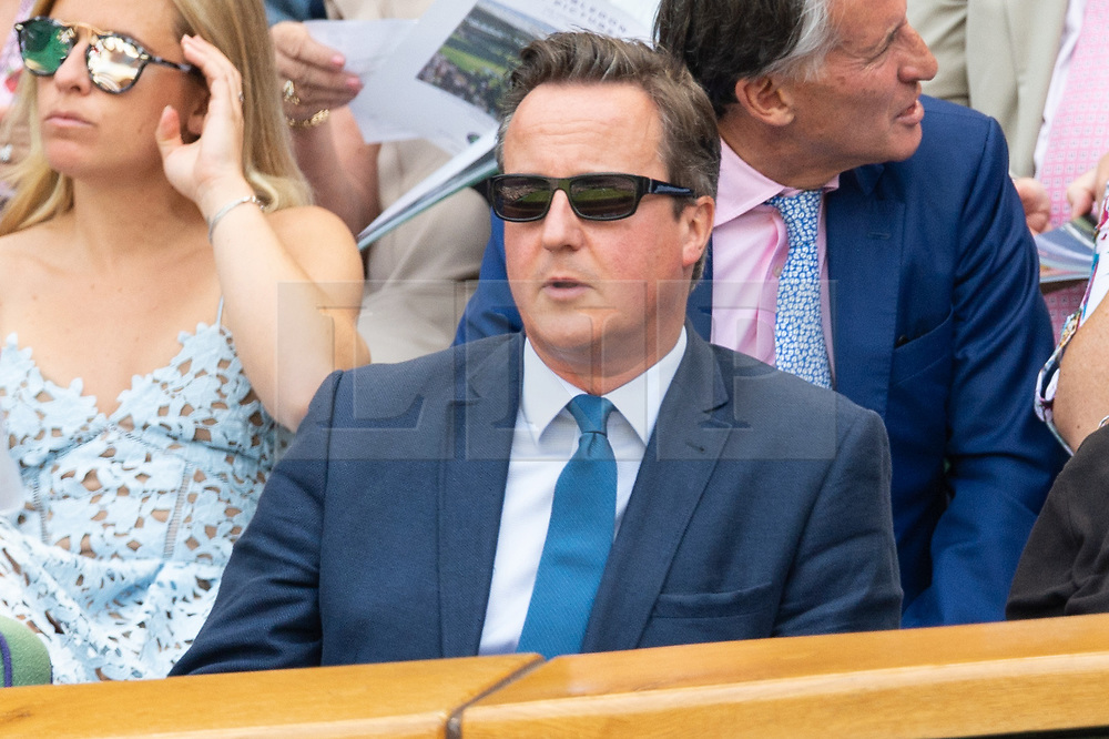 © Licensed to London News Pictures. 06/07/2018. London, UK. David Cameron  arrives on the centre court tennis in the royal box on the fifth day of the Wimbledon Tennis Championships 2018 held at the All England Lawn Tennis and Croquet Club. Photo credit: Ray Tang/LNP