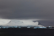 Antarctic ice-covered mountain - the view on approaching Stonington Island, Marguerite Bay, Antarctic Peninsula