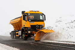© Licensed to London News Pictures. 04/04/2019. Builth Wells, Powys, Wales, UK. A council gritter truck clears the  B4520 road on the Mynydd Epynt range between Builth Wells and Brecon in Powys, UK. Photo credit: Graham M. Lawrence/LNP