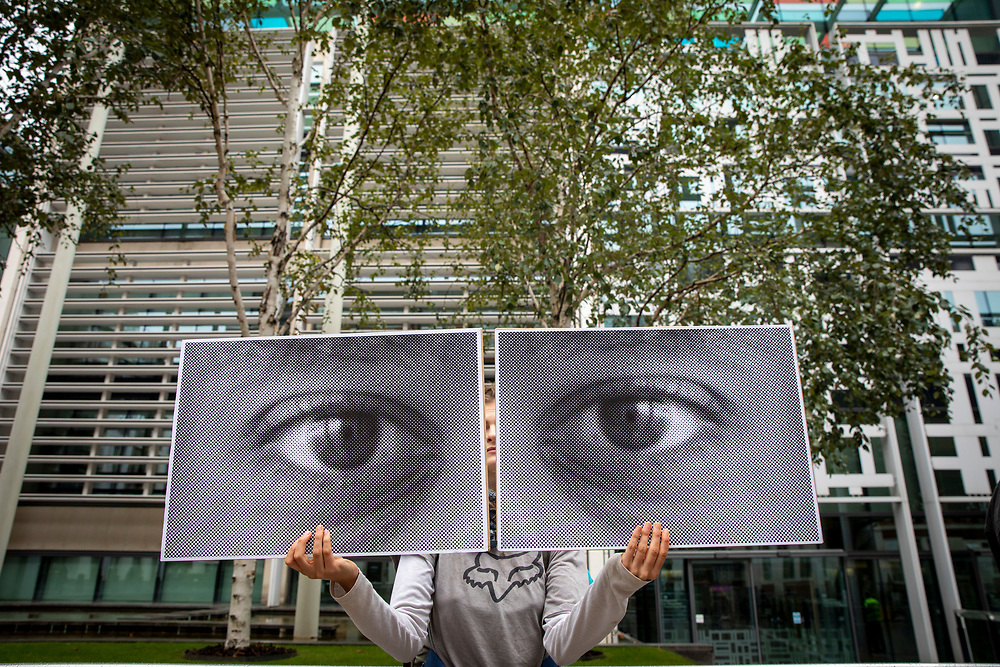 A campaigner holding up watching eyes for a Close Napier Barracks demonstration outside the Home Office headquarters on Marsham street, London, United Kingdom on the 28th September 2021. Napier Barracks has been used by the Home Office to house Asylum seekers for a year now. Close the Camps organised a solidarity demo for the people in Napier Barracks, there have been numerous calls for the camp to close as the facilities have been deemed unsafe for habitation and unfit for purpose. (photo by Andrew Aitchison / In Pictures via Getty Images)