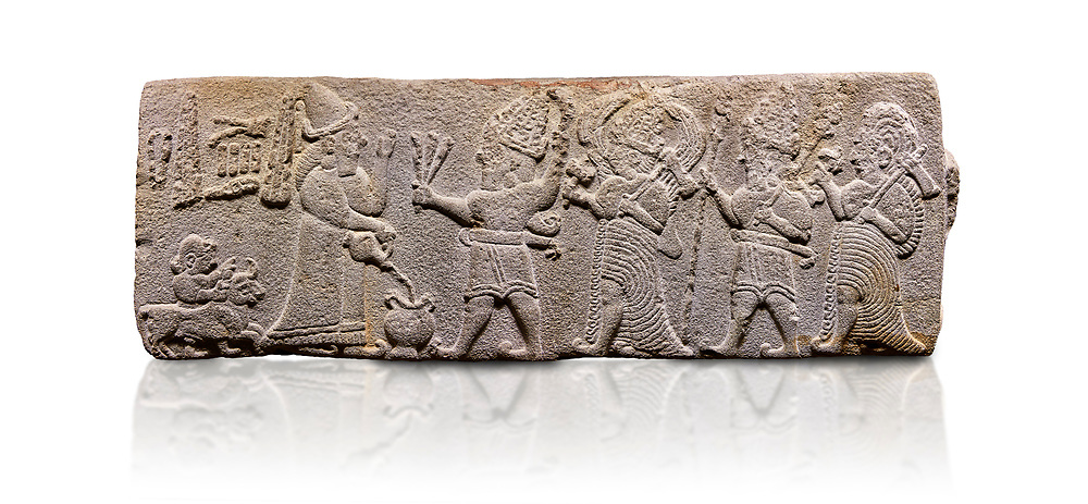 Aslantepe Hittite relief sculpted orthostat stone panel. Limestone, Aslantepe, Malatya, 1200-700 B.C.  Anatolian Civilisations Museum, Ankara, Turkey<br /> <br /> Scene of the king's offering drink and sacrifice to the gods. King pours from the pitcher to the vessel (libation); behind the king is a servant bringing a sacrifice. Storm God across the king holds Teshup, a triple lightning bundle - sickle, and a spear-mace set in the other orthostat; the goddess Ishtar holds weapon in both. All six figures have shoes with the curled ends. <br /> <br /> Against a white background. <br /> <br /> If you prefer to buy from our ALAMY STOCK LIBRARY page at https://www.alamy.com/portfolio/paul-williams-funkystock/hittite-art-antiquities.html . Type - Aslantepe - in LOWER SEARCH WITHIN GALLERY box. Refine search by adding background colour, place, museum etc.<br /> <br /> Visit our HITTITE PHOTO COLLECTIONS for more photos to download or buy as wall art prints https://funkystock.photoshelter.com/gallery-collection/The-Hittites-Art-Artefacts-Antiquities-Historic-Sites-Pictures-Images-of/C0000NUBSMhSc3Oo