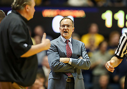 Jan 6, 2018; Morgantown, WV, USA; Oklahoma Sooners head coach Lon Kruger talks with West Virginia Mountaineers head coach Bob Huggins after a foul was called during the second half at WVU Coliseum. Mandatory Credit: Ben Queen-USA TODAY Sports