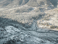 Early morning aerial view of snow-covered Manali city overlooking Beas river of Himachal Pradesh state in North of India.