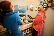 Marrakech, Maroc. 21 Decembre 2007..Aid El Kebir est une des fetes les plus importantes de l'Islam. ..Marrakesh, Morocco. December 21st 2007..Mustapha's sisters, Hayat (left) and Hachoma (right) prepare the meal for Eid Al-Adha. Eid Al-Adha is one of the most important celebrations in the Islam traditions.