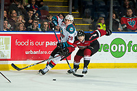 KELOWNA, CANADA - JANUARY 26: Dylan Plouffe #6 of the Vancouver Giants stick checks Nolan Foote #29 of the Kelowna Rockets during first period on January 26, 2019 at Prospera Place in Kelowna, British Columbia, Canada.  (Photo by Marissa Baecker/Shoot the Breeze)