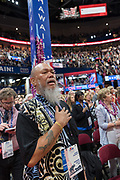 A GOP delegate sing the national anthem during the Republican National Convention July 20, 2016 in Cleveland, Ohio.