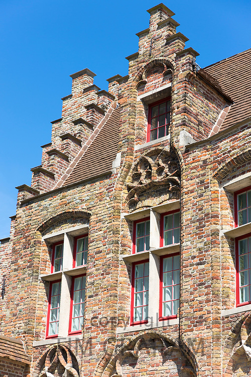 Traditional Belgian architecture crow-stepped gable ( crow steps) and terracotta roof tiles in Bruges, Belgium