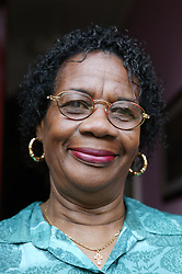 Portrait of a woman smiling, 291104 Black African Caribbean women adult adults lady ladies elderly pensioner pensioners oap oaps age aged old smile smiling happy