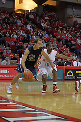 21 November 2009: Stan Januska drives the baseline with Terry Johnson guarding. The Ospreys of North Florida fall to the Redbirds of Illinois State 71-55 on Doug Collins Court inside Redbird Arena in Normal Illinois.