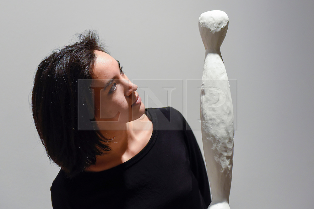 """© Licensed to London News Pictures. 17/02/2017. London, UK.   A staff member views """"Pillar"""" by Louise Bourgeois, at a preview of """"Traumata: Bourgeois/Kusama"""".  The joint exhibition is dedicated to the work of Louise Bourgeois and Yayoi Kusama, and takes place at Sotheby's S/2 Gallery 23 February to 13 April. Photo credit : Stephen Chung/LNP"""