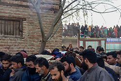 March 28, 2019 - Pulwama, Jammu and Kashmir, India - (EDITORS NOTE: Image depicts death).Kashmiri villagers are seen carrying the dead body of Slain Basharat Ahmed Mir for burial at his residence in Pulwama..Basharat got killed along with his two associates in a gunfight with Indian paramilitary forces in Keller area of South Kashmir's Shopian some 65 Kms from summer capital Srinagar. Four militants were killed by Indian paramilitary forces in separate gunfights in Kashmir Police said. (Credit Image: © Idrees Abbas/SOPA Images via ZUMA Wire)