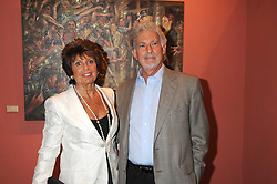 GILL CATTO and RONALD SWYER at a private view of work by Sacha Newley entitled 'Blessed Curse' in association with the Catto Gallery held at the Arts Club, Dover Street, London W1 on 2nd July 2008.<br /><br />NON EXCLUSIVE - WORLD RIGHTS