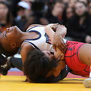Girl wrestlers Amy Farusho, New Jersey, in action against  Ronnie Green, (top), New York City, during the 'Beat The Streets' USA Vs The World, International Exhibition Wrestling in Times Square. New York, USA. 7th May 2014. Photo Tim Clayton