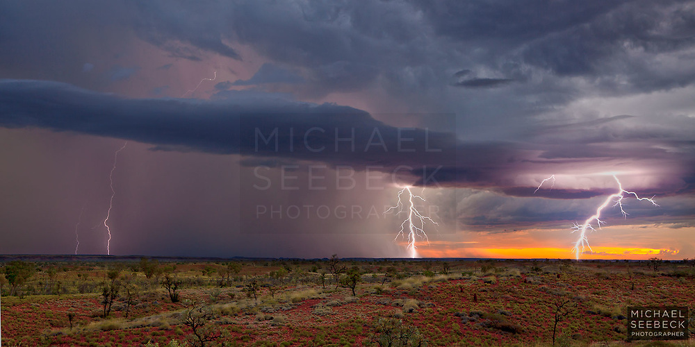 A severe thunderstorm moves slowly over the Tanami Desert in the late afternoon, throwing off multiple lightning ground strikes in quick succession.<br /> <br /> Limited Edition print
