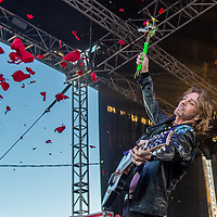 """Rick Springfield lets fly a bunch of roses to the crowd. Rick Springfield makes his fifth appearance at the NYS Fair Saturday, August 31, 2019, playing popular hits like """"Jesse's Girl"""" and """"An Affair of the Heart"""" as well as new songs from his """"Orchestrating My Life"""" Album."""