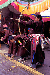 Asia, Northern India, Ladakh, Leh, men at Dartse (archery) contest in gonchas (wool gowns) and gondas (stovepipe hats)