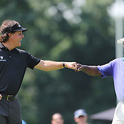Phil Mickelson, (left),  congratulates a playing partner during the ProAm at The Barclays Golf Tournament at The Ridgewood Country Club, Paramus, New Jersey, USA. USA. 20th August 2014. Photo Tim Clayton