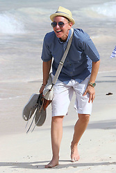 Ellen DeGeneres and Portia De Rossi take a stroll on Saint Jean beach after lunch at the Eden Rock restaurant in Saint Barthelemy island on December 25, 2015. Photo by ABACAPRESS.COM  | 528444_023 St Barthelemy France