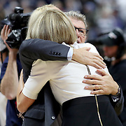 UNCASVILLE, CONNECTICUT- DECEMBER 19:  Head coach Geno Auriemma of the UConn Huskies and assistant coach Chris Dailey embrace during celebrations after recorded their 1000th win as head coach and assistant coach of the team during the Naismith Basketball Hall of Fame Holiday Showcase game between the UConn Huskies Vs Oklahoma Sooners, NCAA Women's Basketball game at the Mohegan Sun Arena, Uncasville, Connecticut. December 19, 2017 (Photo by Tim Clayton/Corbis via Getty Images)