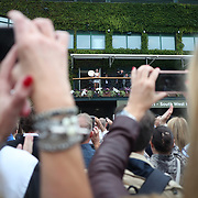 LONDON, ENGLAND - JULY 15:  Garbine Muguruza of Spain, shows fans her winners trophy from the balcony outside centre court after her victory in the Ladies Singles final against Venus Williams of The United States during the Wimbledon Lawn Tennis Championships at the All England Lawn Tennis and Croquet Club at Wimbledon on July 15, 2017 in London, England. (Photo by Tim Clayton/Corbis via Getty Images)
