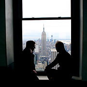 A view of Manhattan, New York, from the Top of the Rock, the observatory deck at Rockefeller Center showing the Empire State Building, Manhattan, New York, USA. Photo Tim Clayton