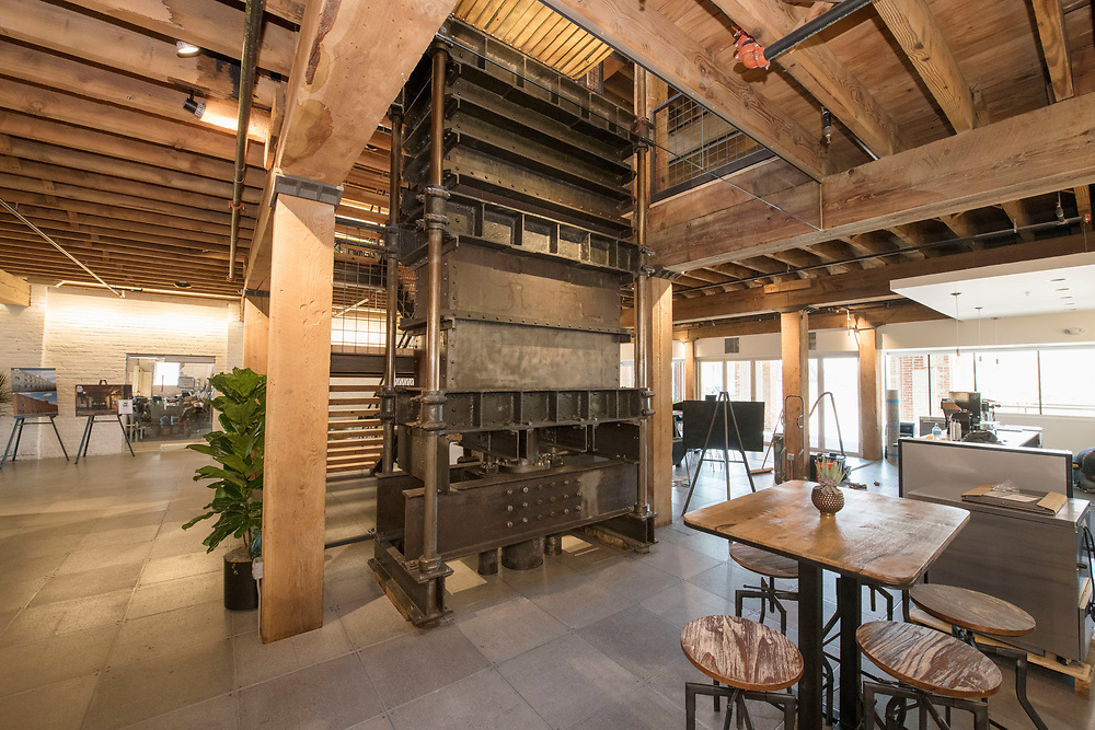 DENVER – NOV. 3. A large, disused industrial textile baler is centerpiece in a ground floor foyer at Steam on the Platte – a new and historic reuse space recently developed at 14th and Zuni streets – in Denver's Sun Valley neighborhood. (Photo by Andy Colwell/Special to The Denver Post)
