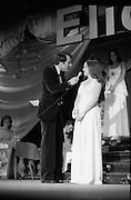 """""""Miss Elida"""" Final At Mosney, Co Meath..1976..01.09.1976..09.01.1976..1st September 1976..The final of the """"Miss Elida"""" lovely hair competition was held in The Gaiety Theatre,Butlins Holiday Centre,Mosney,Co Meath tonight. The competition is sponsored by Lever Bros,Sheriff St,Dublin. The shows compere was Mr Mike Murphy..Image shows Mike Murphy interviewing one of the contestants on stage at the Gaiety Theatre."""