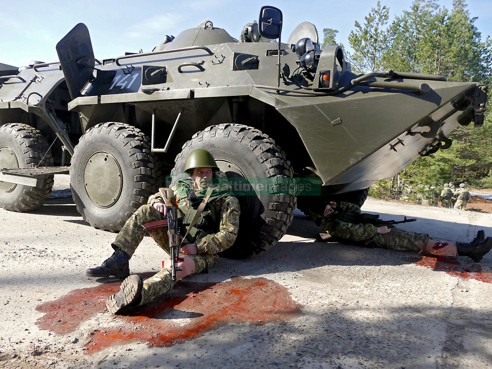 March 29, 2019 - Orshanets, Cherkasy Region, Ukraine - Servicemen who act as the wounded stay beside a military vehicle during an exercise in tactical medicine at the Maj Gen Ihor Momot Main Personnel Training Centre of the State Border Guard Service, Orshanets village, Cherkasy Region, central Ukraine, March 29, 2019. Ukrinform. (Credit Image: © Yulii Zozulia/Ukrinform via ZUMA Wire)
