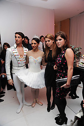 Left to right, dancer from the ENB, PRINCESS BEATRICE OF YORK and PRINCESS EUGENIE OF YORK at the launch of the English National Ballet's Christmas season 2009 held at the St.Martin;s Lane Hotel, London on 15th December 2009.